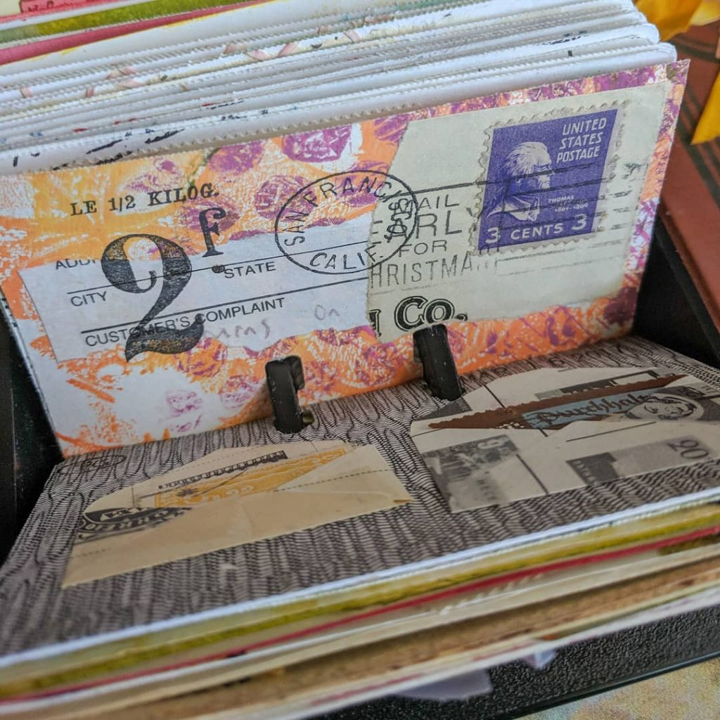 some mail-art collaged Rolodex cards in purple and orange