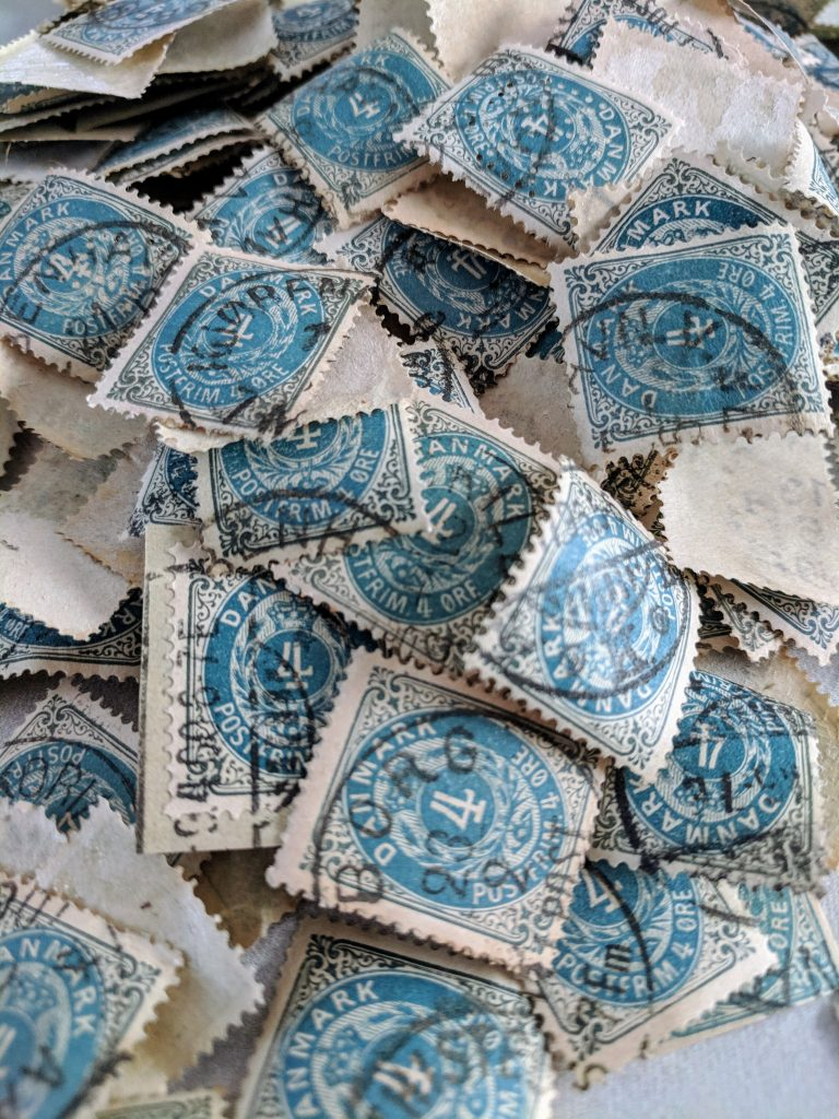 a pile of loose stamps