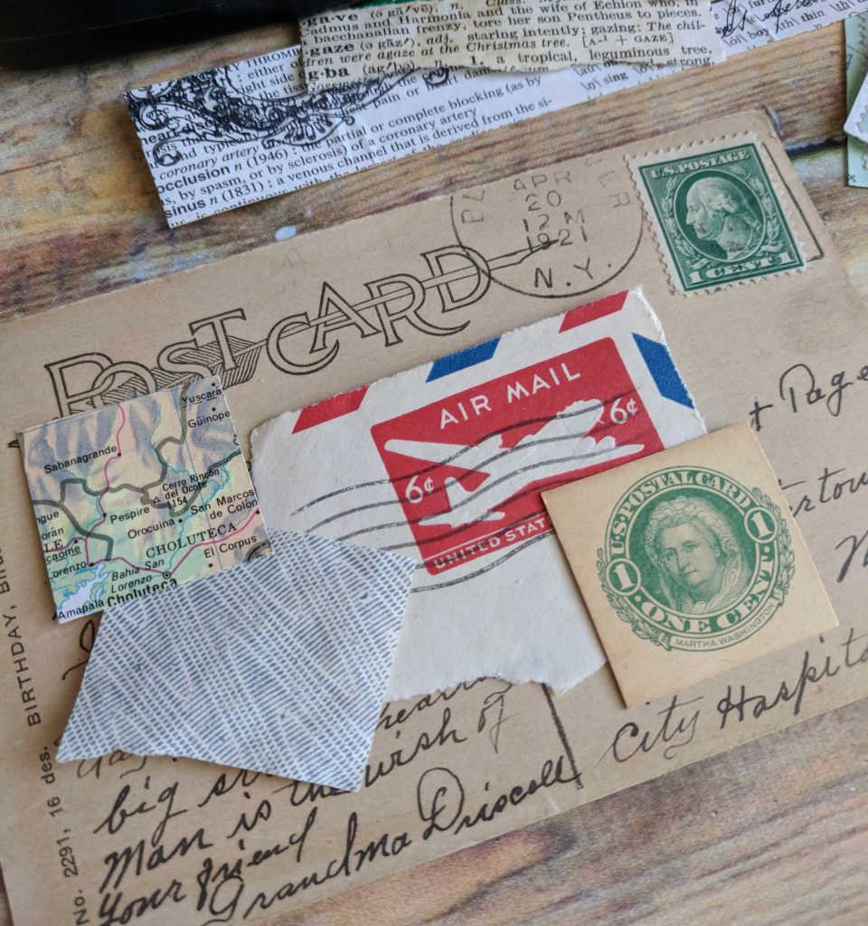A postcard is collaged with postal mail ephemera