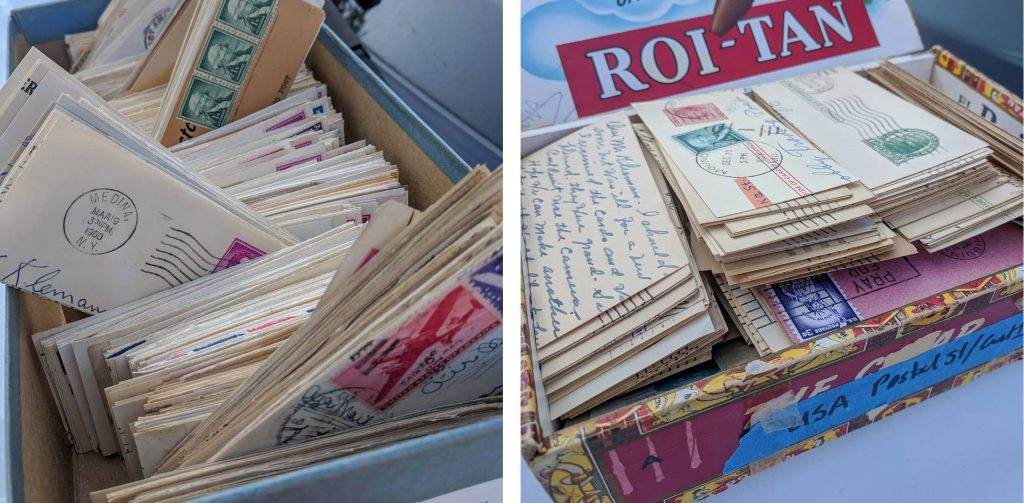 shoe boxes filled with cards of postage stamps with postmarks
