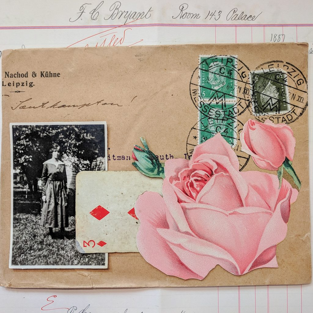 a vintage envelope collaged with a rose, a playing card and a photo