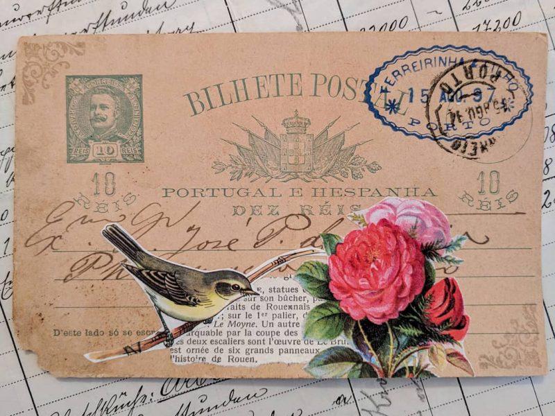 a cutout of a bird on an old postcard