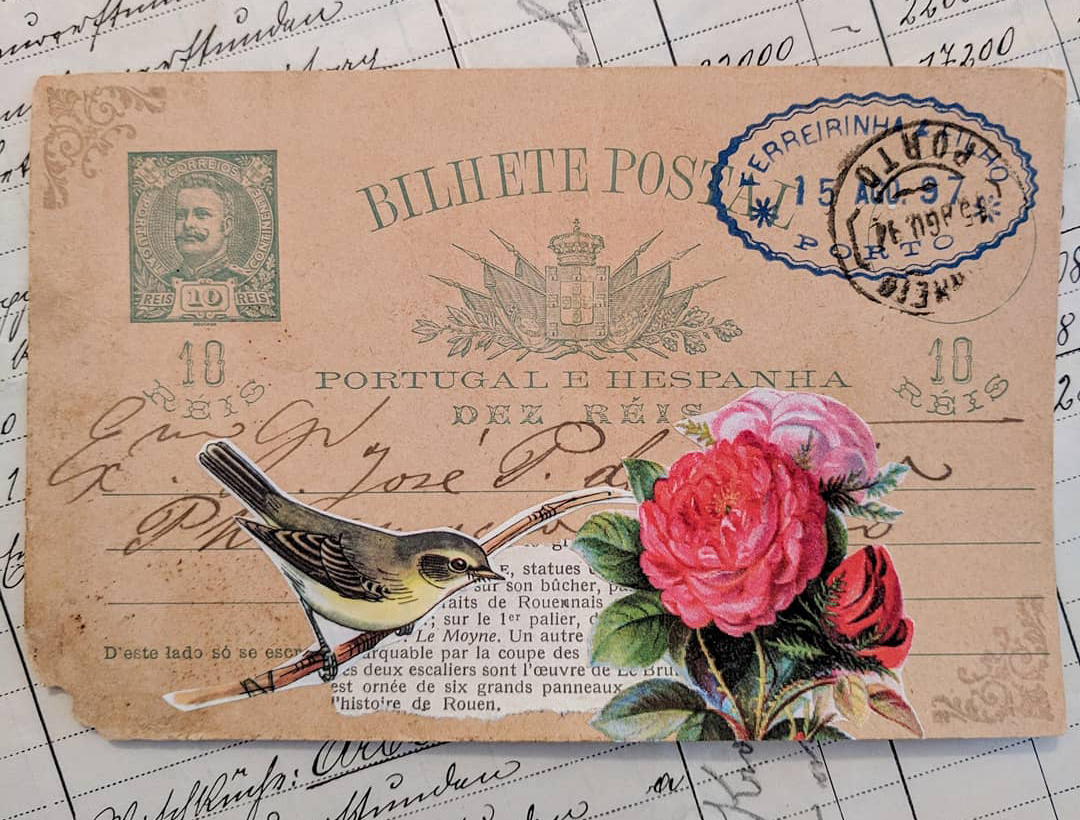 a cutout of a bird on an old postcard