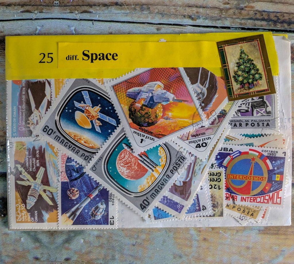 a small plastic envelope filled with space-related postage
