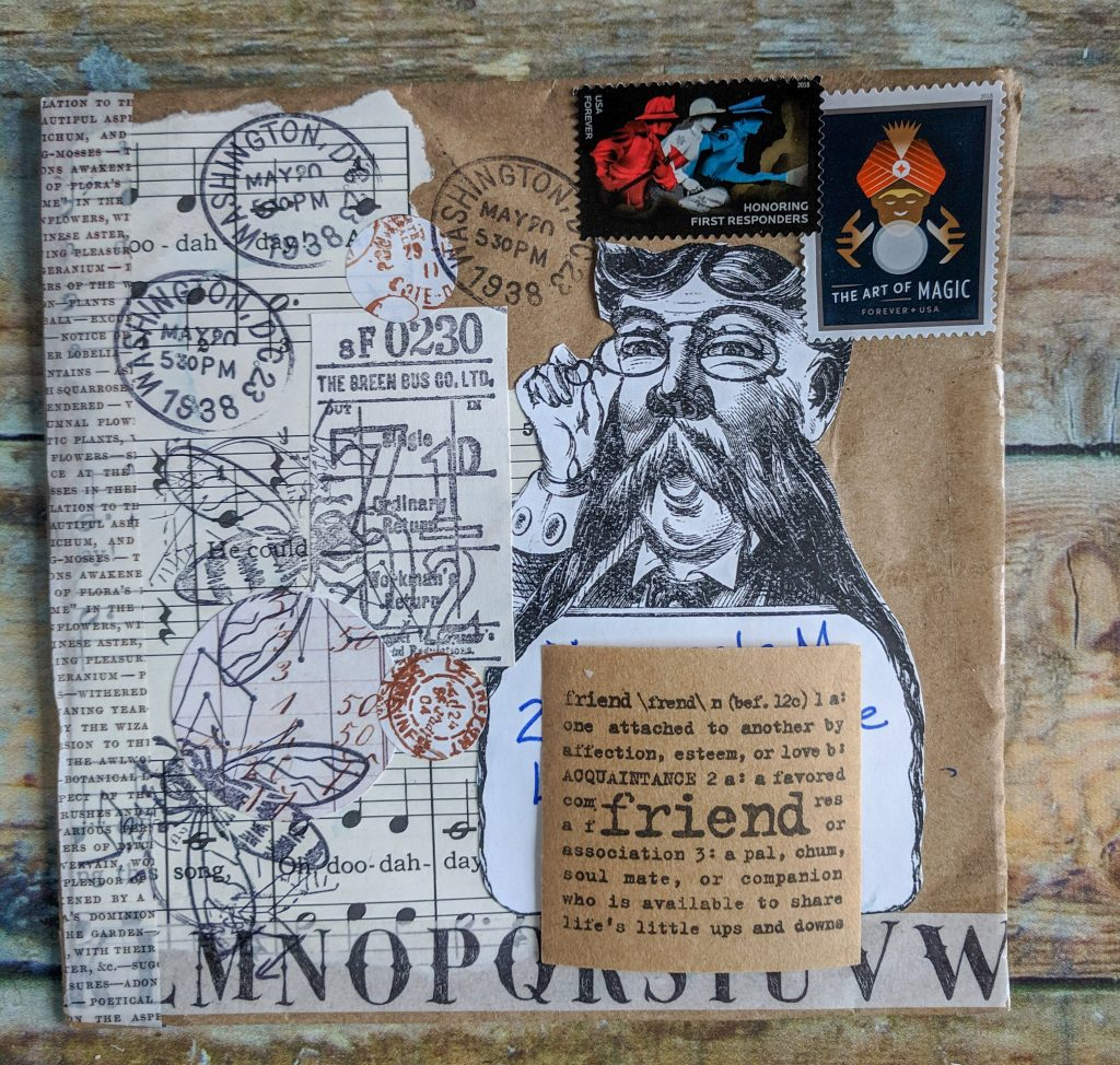 an envelope collaged with papers and stamps