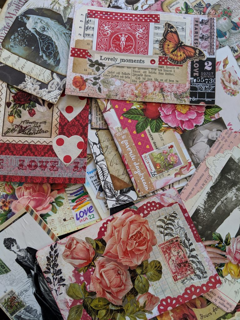 "a huge pile of pink and red colored ""love"" postcards"