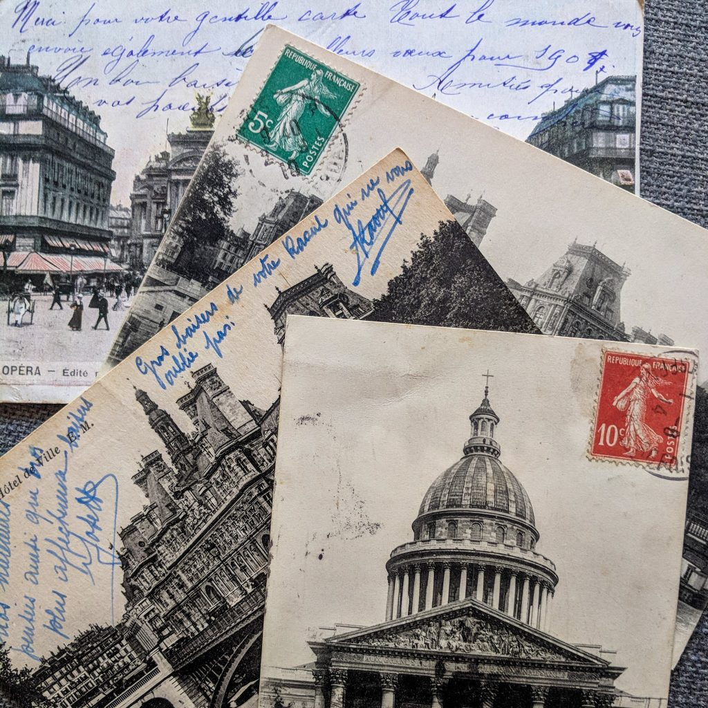 old postcards with architecture on the front. Many have visible handwriting on them