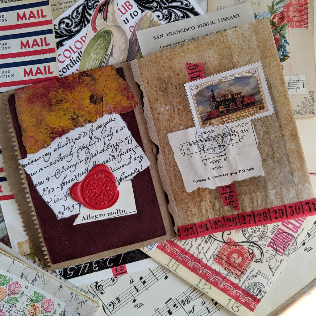 A spread of various pieces of paper decorated with a locomotive postage stamp.