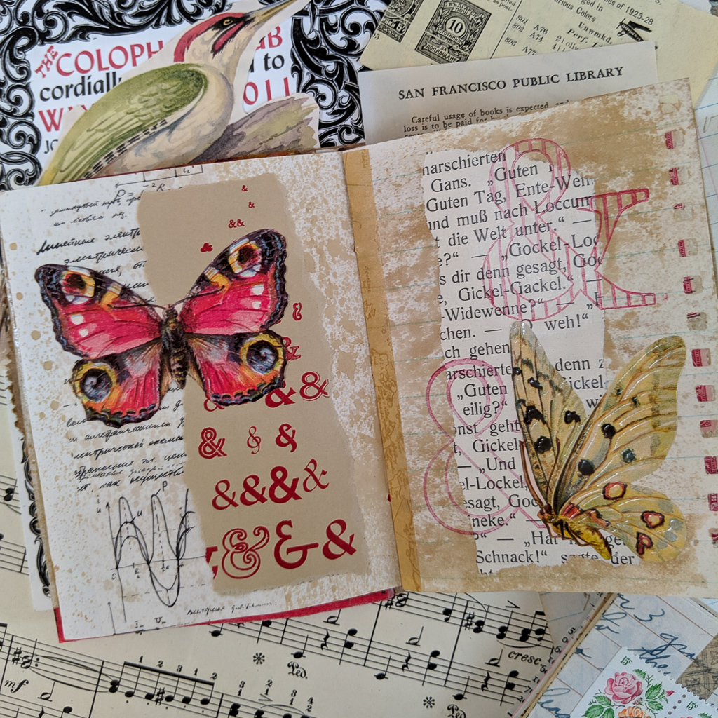 A spread of 2 pages collaged with text and butterflies