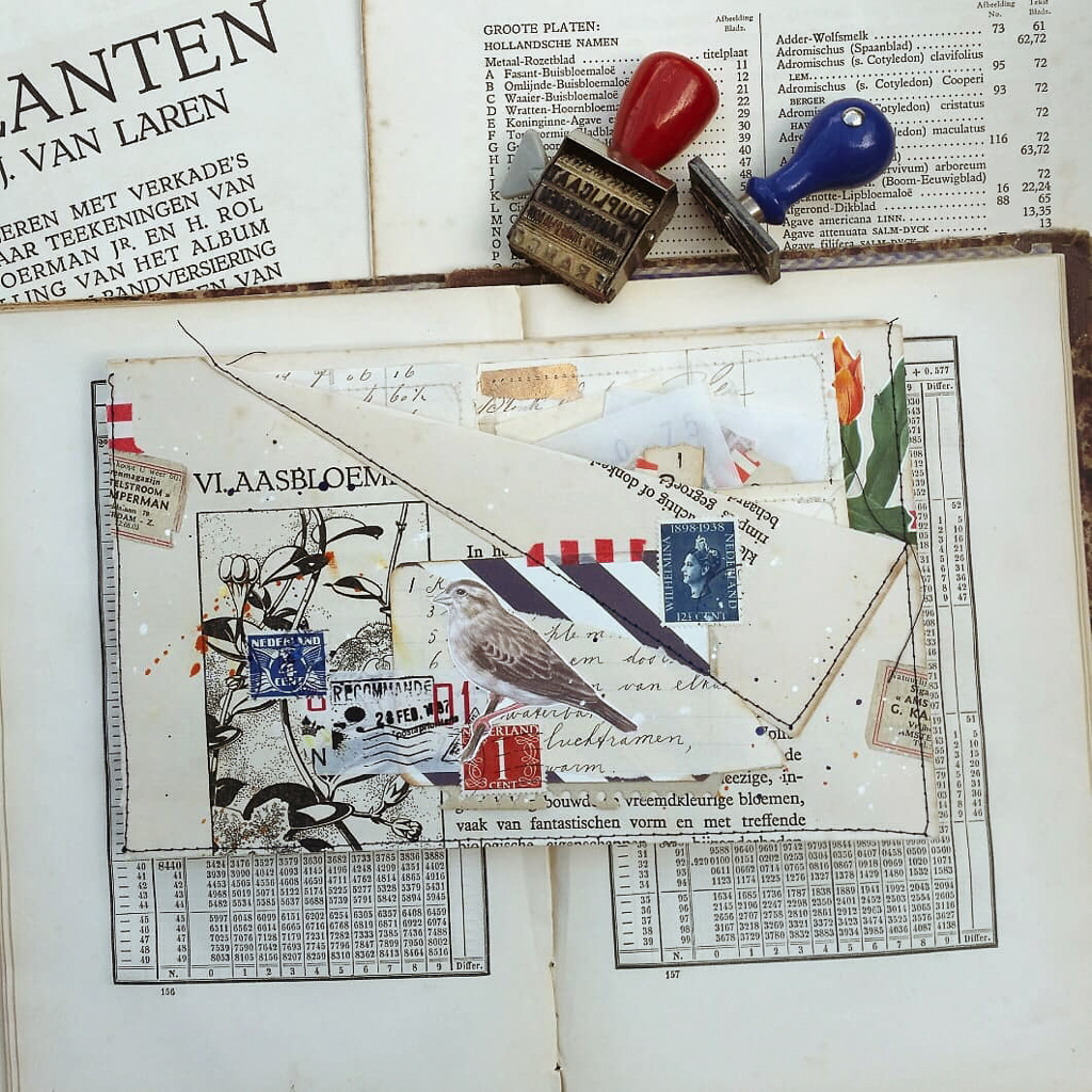 A folio of vintage ephemera lies on a book