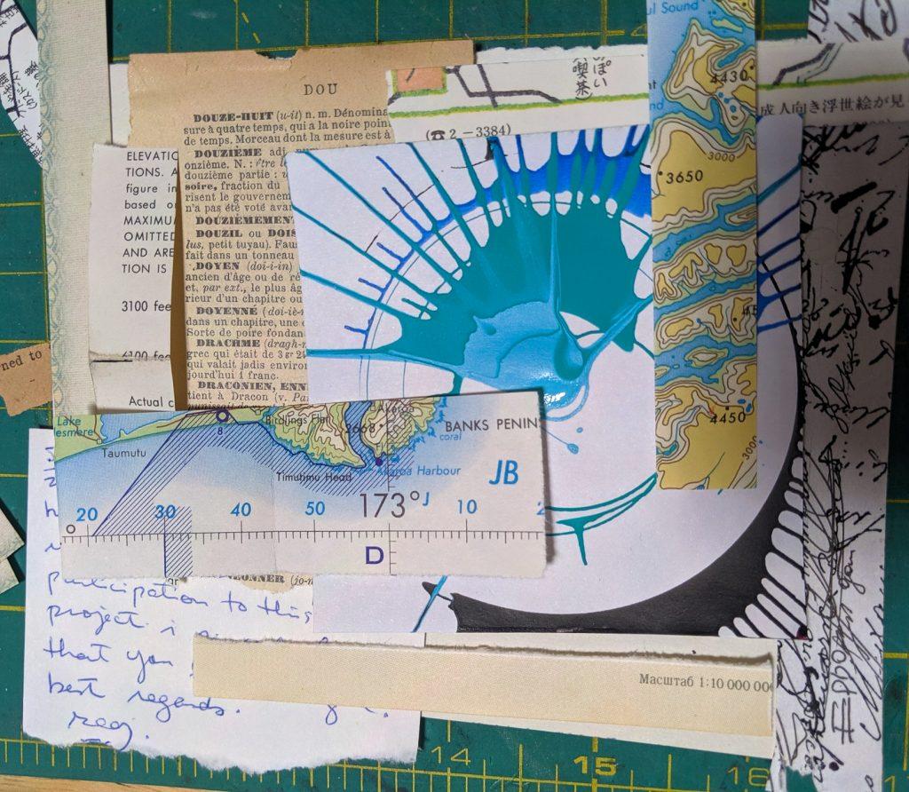 Random scraps of cream colored paper surround a piece of spin art