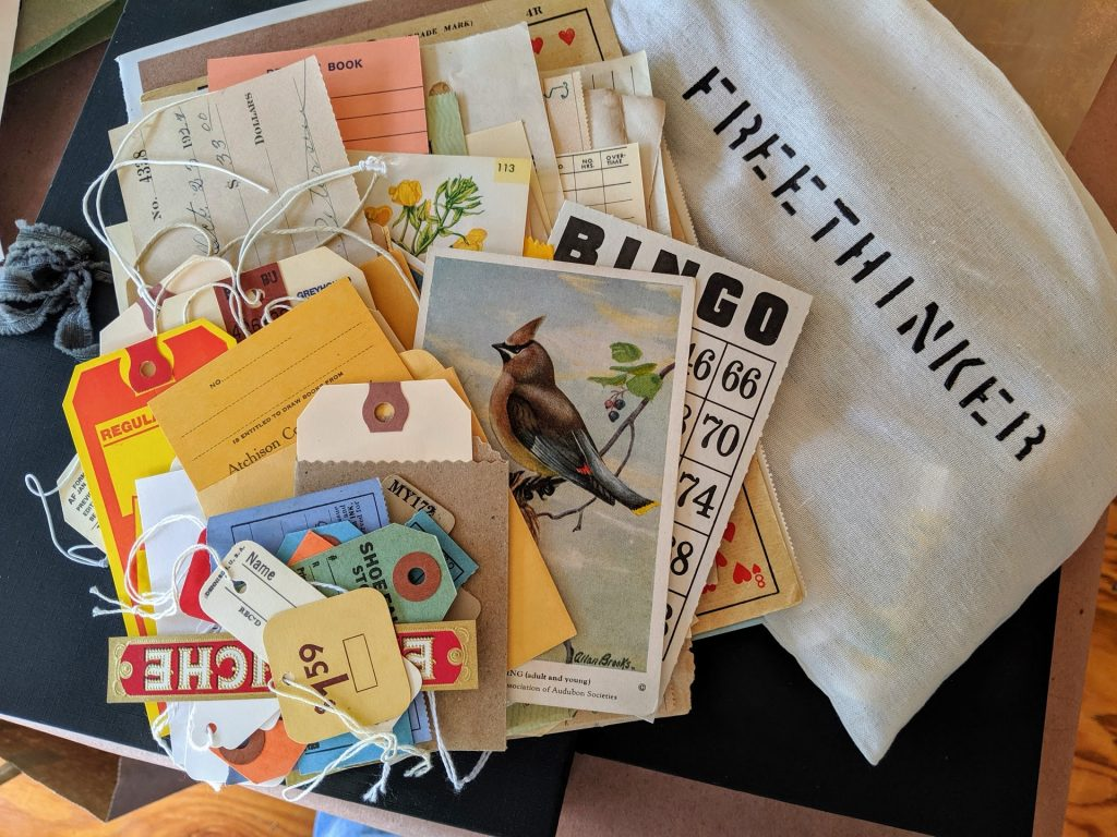 A cloth bag was filled with paper vintage ephemera