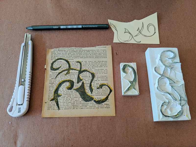 tools to carve rubber stamps and a sampling of how the stamp turned out