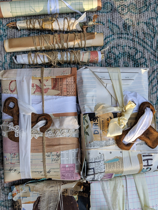altered papers and pages are wrapped along with rusted pieces so that interesting colors transfer