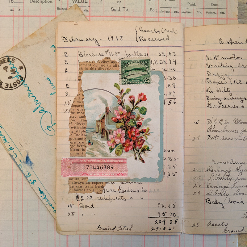 a piece of postcard and other bits of ephemera on a vintage ledger page