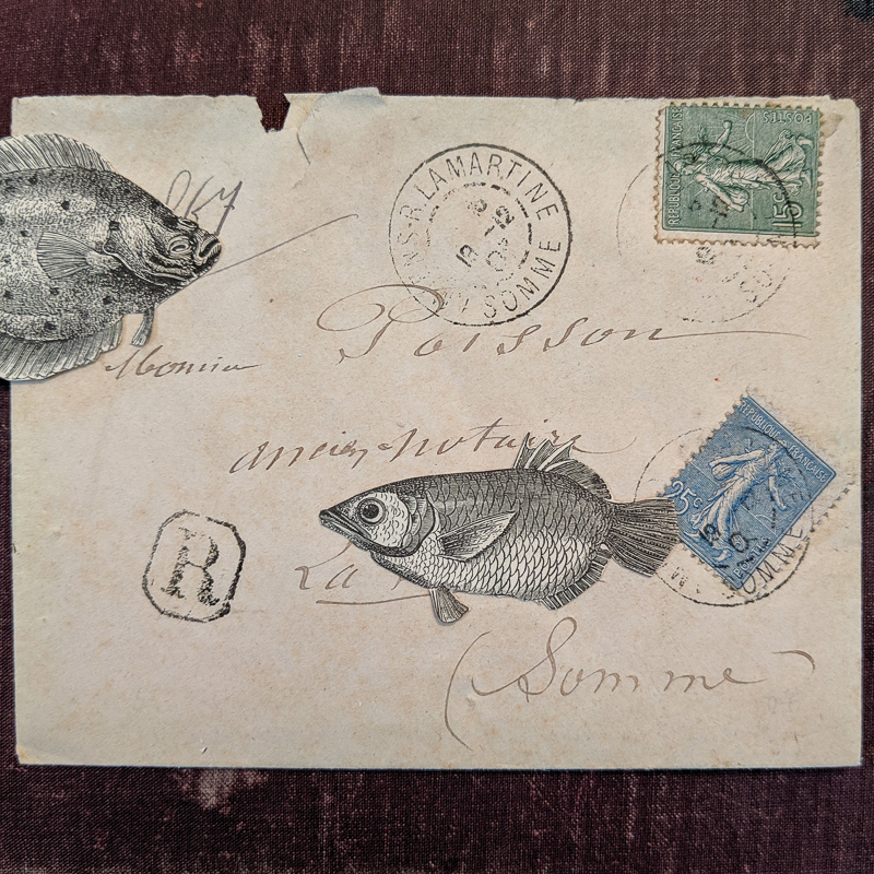 A vintage cover is decorated with fish