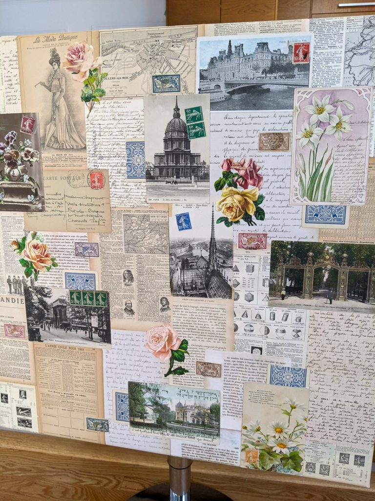 A canvas collaged with vintage French papers and postage stamps.