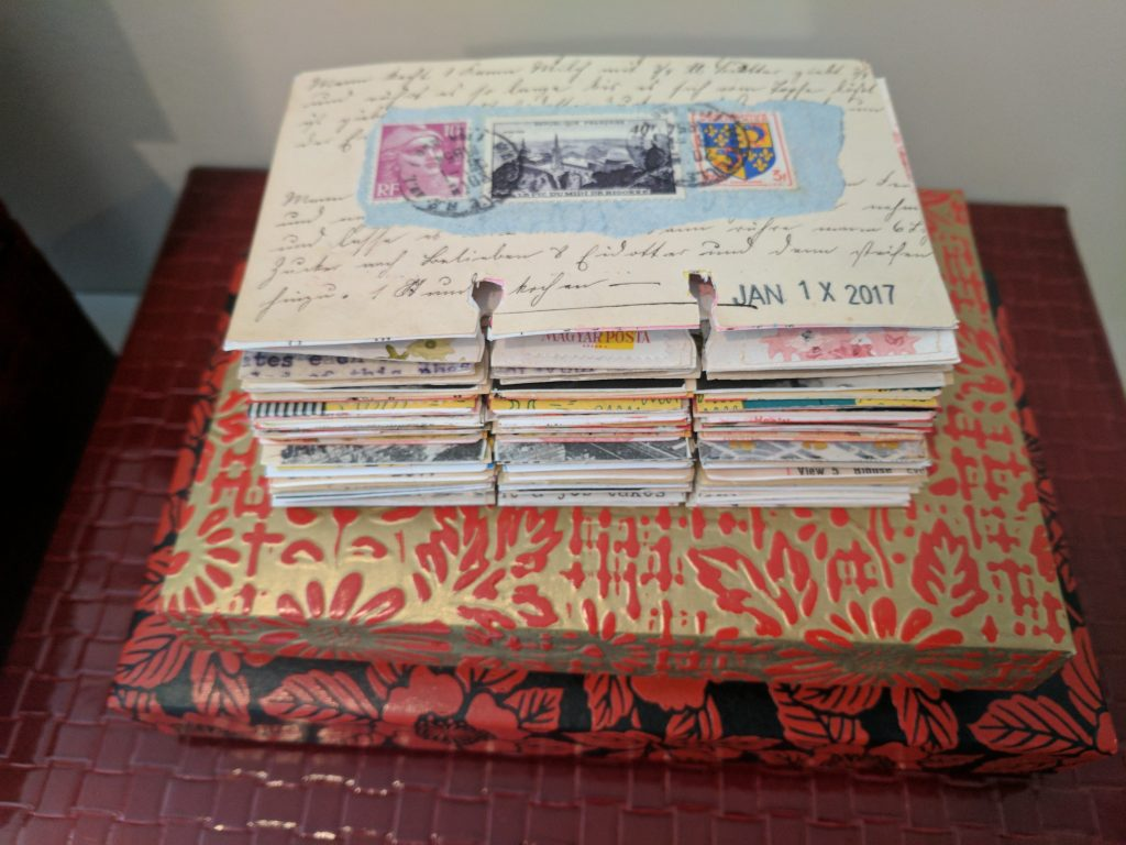 a stack of rolodex art cards
