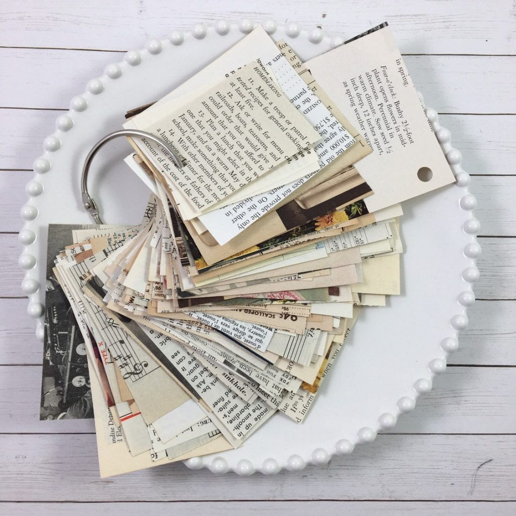 a metal ring holds a stack of vintage scrap papers