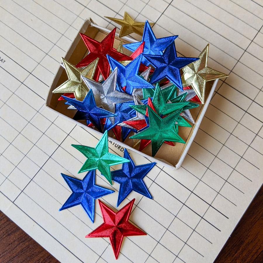 loose gummed stars in colored foil